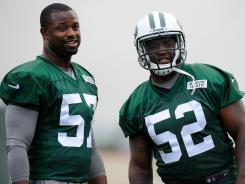 New York Jets linebackers Bart Scott (57) and David Harris (52) look on during training camp at SUNY Cortland on Friday, July 27.