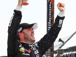Jimmie Johnson celebrates his fourth Brickyard 400 win in the last seven seasons.