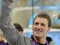 Ryan Lochte waves to the crowd after winning the gold medal in the men's 400 individual medley in the London Games on Saturday.