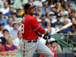 Nationals first baseman Michael Morse hit a game-tying two-run home run in the ninth inning against the Milwaukee Brewers, and won it for Washington in the 11th.