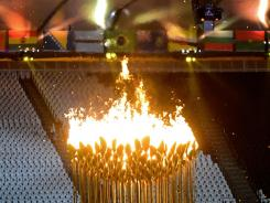 The Olympic flame, shown during the opening ceremony for the London Games, can be seen only from inside the track and field stadium.