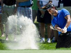 RBC Canadian Open champion Scott Piercy chips out of the bunker on the first hole during the final round Sunday at Hamilton Golf and County Club in Ancaster, Ontario.