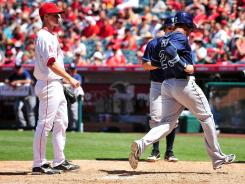 Rays first baseman Carlos Pena scored a run in the seventh inning off of a wild pitch from Angels starter Zack Greinke.
