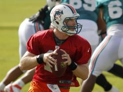 Miami Dolphins quarterback Ryan Tannehill rolls out during practice Sunday, July 29, 2012 in Davie, Fla.