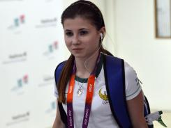 Gymnast Luiza Galiulina of Uzbekistan, arriving last week at Heathrow airport, has been provisionally suspended for a positive doping test.