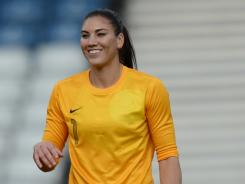 United States goalkeeper Hope Solo smiles after the 3-0 win over Colombia on Saturday.