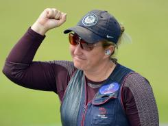 Kimberly Rhode pumps her fist after winning the women's skeet shooting competition at London's Royal Artillery Barracks. Rhode won with an Olympic-record score of 99.