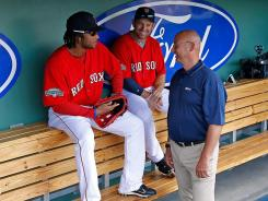 Terry Francona, who managed the Red Sox from 2004-11, chatted with several players in the locker room before Saturday's game against the New York Yankees while preparing for his job as a broadcaster for Sunday night's game on ESPN.