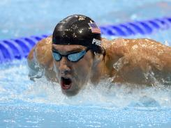Michael Phelps finished third, one spot behind Tyler Clary in a 200 butterfly heat.