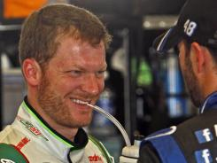 Points leader Dale Earnhardt, Jr., left, shares a laugh with teammate Jimmie Johnson last month at Kentucky Speedway.