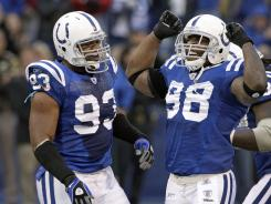The Colts' Robert Mathis, right, celebrates with Dwight Freeney on Nov. 1, 2009, after a sack against the 49ers.