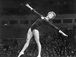 Soviet Larissa Latynina performs her routine on the beam during the 1956 Olympic Games in Melbourne, Australia. She won four gold medals in Melbourne, three golds in Rome in 1960 and two golds in Tokyo in 1964.