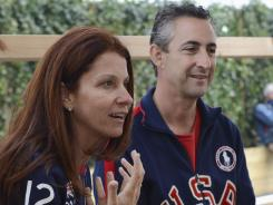 Lynn (left), and Rick Raisman, parents of Alexandra Raisman, recount their excitement watching their daughter's performance during the all-around preliminaries on Sunday.