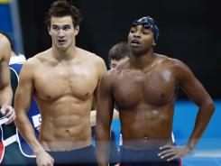 Nathan Adrian, left, and Cullen Jones, seen here after Sunday's 4x100 relay, will swim in the 100-meter freestyle prelims on Tuesday morning.