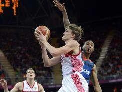 Forward Andrei Kirilenko, with the ball, scored 35 points in Russia's opening Olympic victory vs. against Great Britain. The London Games is the start of Kirilenko's journey back to the NBA, where he will play for the Minnesota Timberwolves after sitting out last season.