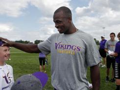 Minnesota Vikings running back Adrian Peterson meets with fans at training camp at Blakeslee Stadium at Minnesota State University, Mankato.