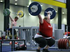Weight-lifter Holley Mangold, of the United States, trains in preparation for the start of the London Olympics.