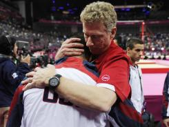 American gymnast John Orozco is consoled by coach Kevin Mazeika after a fifth-place finish the men's team final.