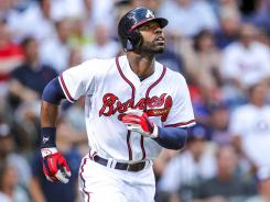 Atlanta right fielder Jason Heyward watches the ball fly over the fence after hitting a solo home run in the third inning against the Miami Marlins.