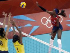 Destinee Hooker rises for a spike in the USA's victory Monday against Brazil.