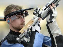 Matthew Emmons of the USA failed to advance to the final Monday in the men's 10-m air rifle competition at Royal Artillery Barracks.