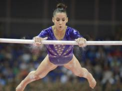 Aly Raisman, competing on the uneven bars, totaled 60.391 points overall Sunday in women's team qualifying, landing a spot in the all-around competition with the second-highest score.