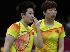 China's Yu Yang, left, and Wang Xiaoli talk while playing against Jung Kyun-eun and Kim Ha-na, of South Korea, in a women's doubles badminton match at the 2012 Summer Olympics.