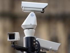 Closed-circuit surveillance cameras are a common sight on London streets, mounted atop light poles and street signs.