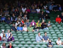 A women's singles tennis match at Wimbledon was played before dozens of empty seats Tuesday.