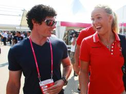 The British tabloids have criticized slumping golfer Rory McIlroy for spending too much time with tennis star and girlfriend Caroline Wozniacki. They were together last week in London ahead of the start of the Summer Olympics.