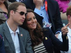 Britain's Duke of Cambridge, Prince William, and Duchess of Cambridge, Catherine, chat during the jumping phase of the eventing competition equestrian venue in Greenwich Park.