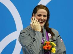 London, United Kingdom; Missy Franklin (USA) reacts on the podium after receiving her gold medal for winning the women's 100m backstroke finals during the London 2012 Olympic Games at Aquatics Centre.