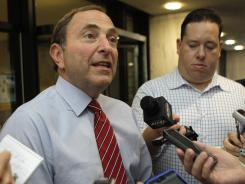 Commissioner Gary Bettman talks to reporters after Tuesday's negotiating session.