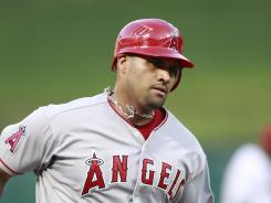 Albert Pujols hit a solo home run in the fourth and another in the Angels' three-run sixth.