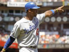 First impression: Dodgers third baseman Hanley Ramirez scores in a 4-0 victory Sunday against the Giants. In his first full series with Los Angeles, the former Marlins star scored three runs, one on a game-winning homer Friday.