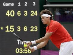 Milos Raonic of Canada prepares to serve at match point in his loss to Jo-Wilfried Tsonga of France in a second-round Olympics match at Wimbledon.