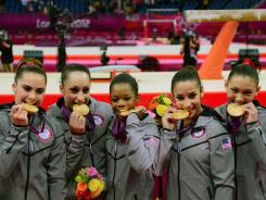 From left, McKayla Maroney, Jordyn Wieber, Gabby Douglas, Alexandra Raisman and Kyla Ross pose with their medals after winning America's first team gold since 1996.