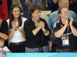 Michael Phelps' mother Debbie, center, was all but certain that her son had won the 200-meter butterfly.