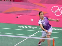 Jung Kyung Eun of South Korea is shown playing a shot during their women's doubles badminton match against China's Wang Xiaoli and Yu Yang at the Olympics on Tuesday. The South Korean is one of eight women expelled from the Games for playing to lose.