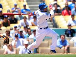 Center fielder Shane Victorino went 0 for 4 in his first game with the Dodgers after being traded from the Phillies.
