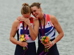 Helen Glover, left, and Heather Stanning celebrate after winning the women's pair final to give Britain its first gold medal of the London Games.