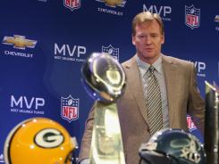 Roger Goodell and Packers QB and Super Bowl XLV MVP Aaron Rodgers attend a press conference in 2011.