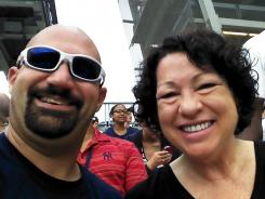 "Supreme Court justice and Bronx native Sonia Sotomayor, right, and ""Bald Vinny"" Milano smile for a photo during a baseball game between the New York Yankees and Baltimore Orioles."