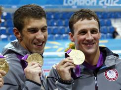 Michael Phelps, left, and Ryan Lochte have teamed to win two relay medals so far at the London Olympics.