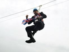 London Mayor Boris Johnson dangles from a zip wire in London's Victoria Park. A publicity stunt at a public viewing area for the Olympic Games went awry leaving Johnson stranded some 15 feet off the ground.