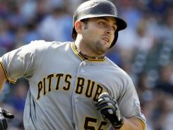 Pirates' Michael McKenry rounds the bases after hitting a three-run home run against the Cubs.