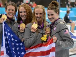 Allison Schmitt, Shannon Vreeland, Dana Vollmer and Missy Franklin pose with their gold medals after the women's 4x200 relay during the London Olympics.