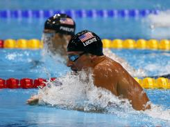 Ryan Lochte (front) and Michael Phelps compete in the semifinals of the 200-meter individual medley during Wednesday. The two stars will go head-to-head for gold in Thursday's final.