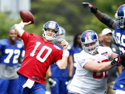 New York Giants quarterback Eli Manning (10) throws a pass during training camp at University Field at SUNY Albany on July, 28.