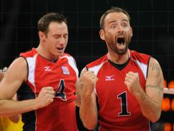 David Lee (4) and Lloy Ball (1) celebrate after the U.S. beat Brazil in the gold medal match at the 2008 Beijing Olympics. The two volleyball powerhouses face off in preliminary play at the 2012 Olympics Thursday.